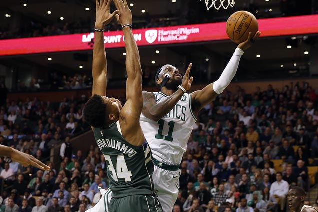 Tatum sizzles early, Irving takes charge late as surging Celtics snap Bucks three-game win run