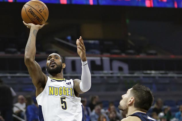 Nuggets recover from slow start to get past Magic