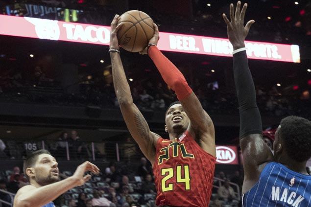 Kent Bazemore hits huge endgame baskets as Hawks down Magic and spoil Nikola Vucevic's triple-double