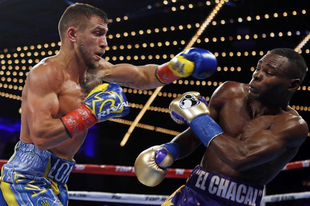 Vasyl Lomachenko wins match of Olympic greats as Guillermo Rigondeaux quits in sixth round
