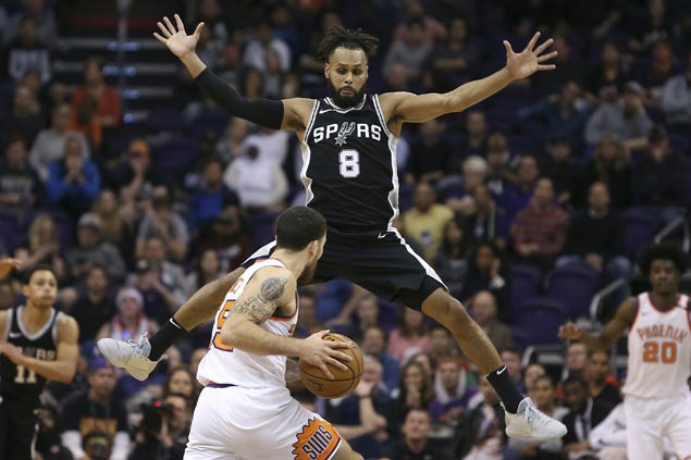 Undermanned Spurs squander huge lead but recover to beat Suns