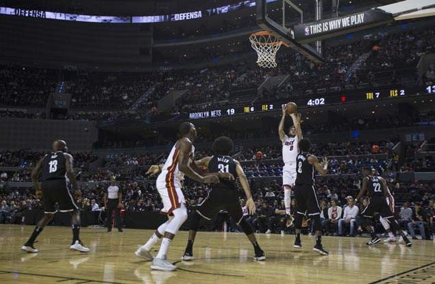 Heat win first game in Mexico, assert mastery over Nets to snap two-game skid