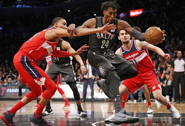 Nets blow double-digit lead but pounce on late Wizards error to save victory