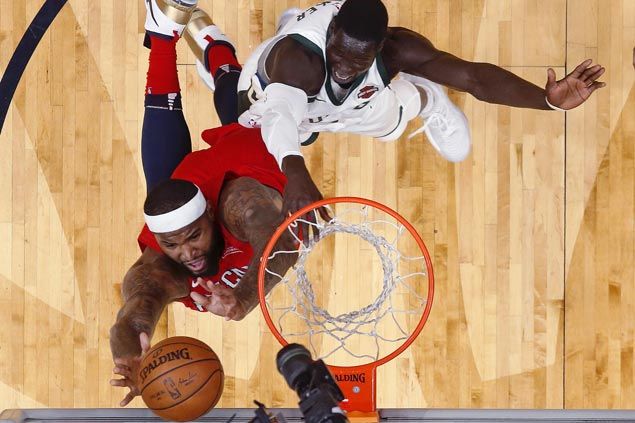 DeMarcus Cousins comes through in the clutch as turnover-prone Pelicans edge Bucks