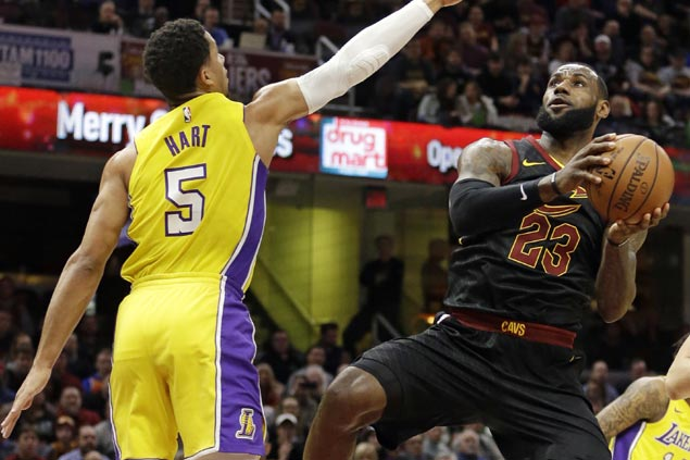 LeBron James triple-double powers Cavs past slow start to turn back skidding Lakers