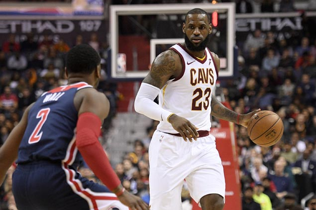 Third straight triple-double by LeBron James powers Cavaliers past Wizards