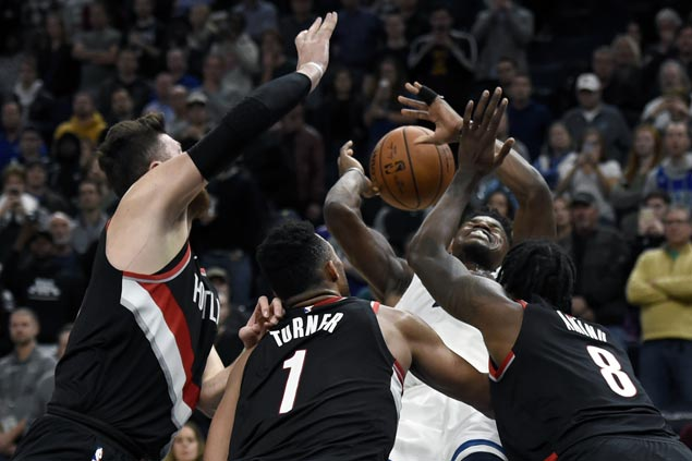 Jimmy Butler shakes off back spasms to score 37 and lift Timberwolves over Blazers