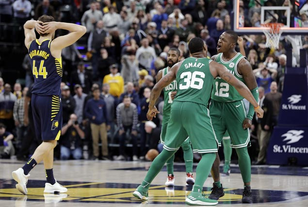Celtics squander huge early lead but mount late rally, capped by Terry Rozier dunk, to nip Pacers