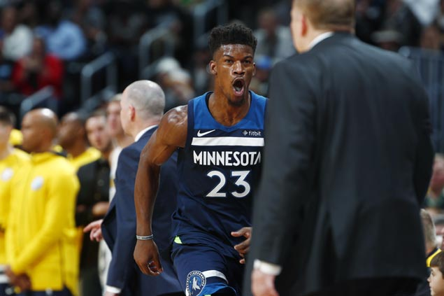 Jimmy Butler takes charge late as Timberwolves rally from 14 points down to stun Nuggets