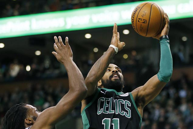 Celtics edge sloppy Nets to close year with three straight victories