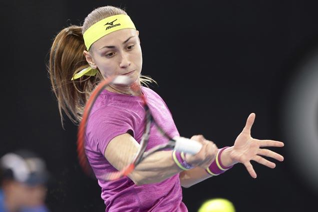Aleksandra Krunic marches on to Brisbane quarters as top seed Garbine Muguruza retires with cramps