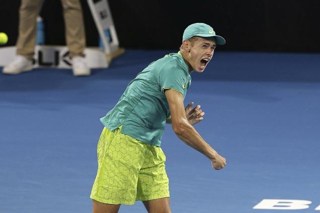 Aussie teen Alex De Minaur upsets former champ Milos Raonic in second round at Brisbane
