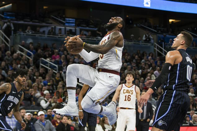LeBron James winds up just short of a triple-double as Cavs edge Magic