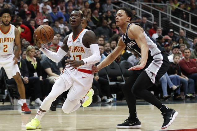 Dennis Schroder comes up clutch to propel Hawks past Spurs as Manu Ginobili suffers thigh contusion