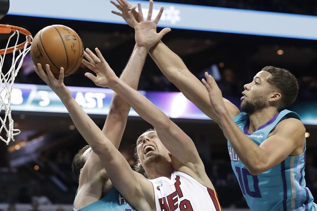 Kelly Olynyk brilliant down the stretch as Heat end Hornets' win run at two