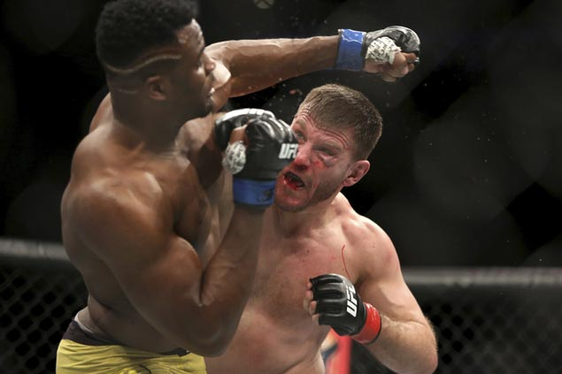 Stipe Miocic outpoints Francis Ngannou to set UFC heavyweight record with third straight title defense