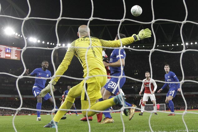 Two fortuitous goals push Arsenal past Chelsea And into League Cup final against City
