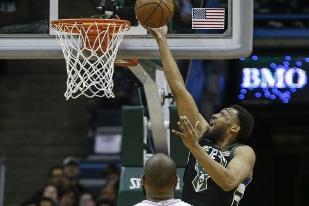 Jabari Parker solid in season debut as Bucks overcome Knicks