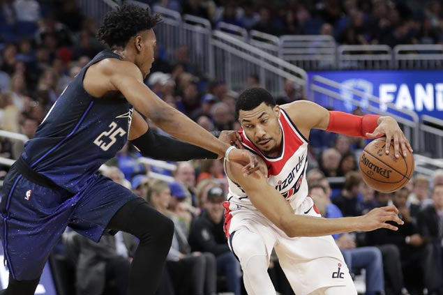 Porter stars as Wizards beat Magic for fourth straight win without Wall