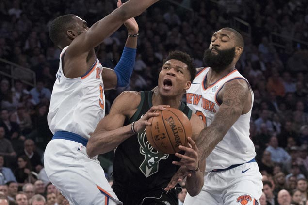 Giannis shows no sign of ankle problem in lifting Bucks past Knicks, who lose Porzingis to knee injury