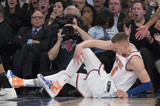 Giannis dunks over woeful Knicks, as Porzingis tears ACL in loss to Bucks
