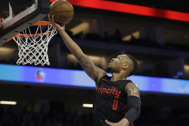 Damian Lillard scores season-high 50 then sits out fourth to watch Blazers finish off Kings