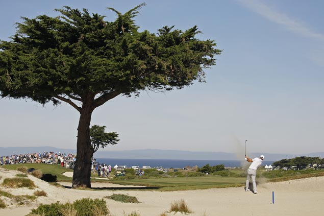Dustin Johnson fires seven-under 64 at Shore Course to gain share of Pebble Beach lead