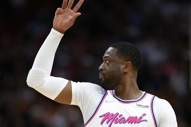 Heat defeat Bucks to halt five-game slide as Dwyane Wade returns to Miami