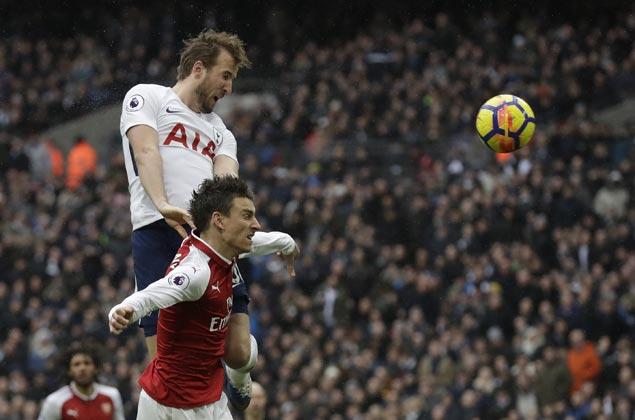 Harry Kane scores header as Tottenham edges Arsenal to move to third in Premier League