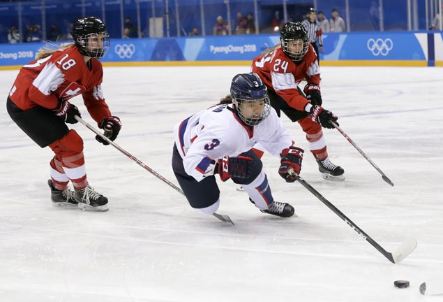 Switzerland wins Olympic opening matchup against combined Korean hockey team