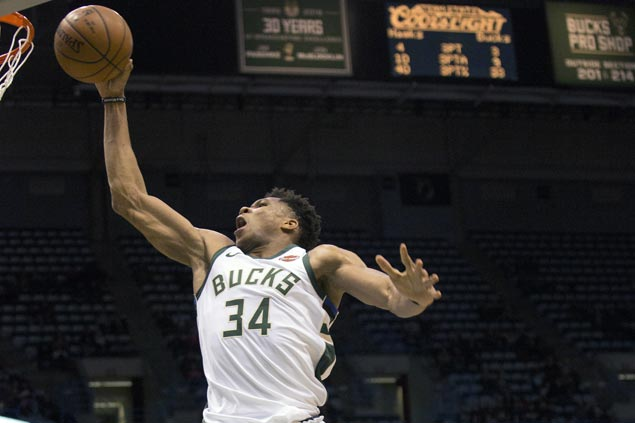Bucks steadier in overtime, halt Raptors' win streak at seven