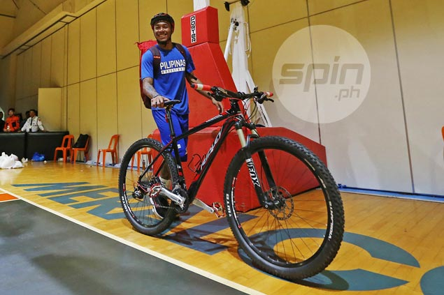 Don't be surprised if you see Calvin Abueva riding a bike in Manila's busy streets