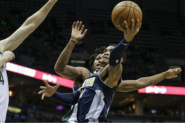 Nuggets tie franchise mark with 24 triples in romp vs Bucks for third win in a row