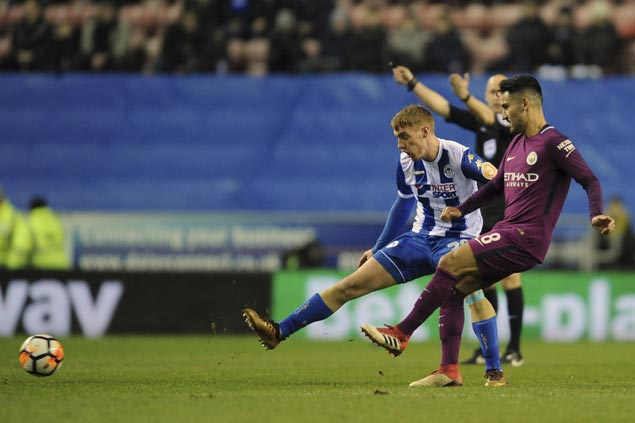 Third-tier Wigan scores stunning FA Cup fifth-round win to end Man City's quadruple bid