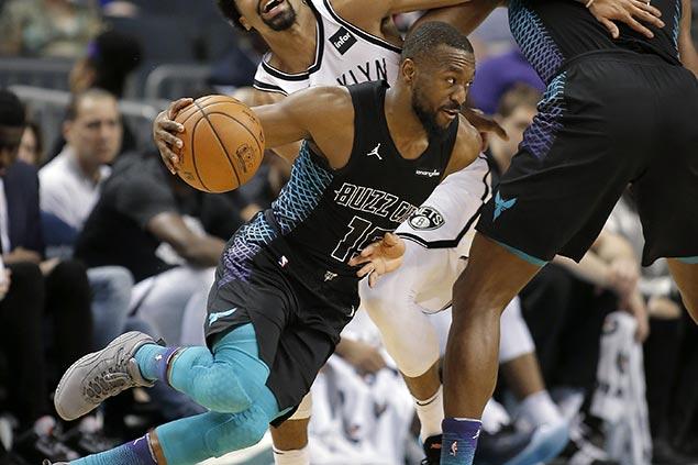 Kemba Walker, Dwight Howard power Hornets romp over slumping Nets