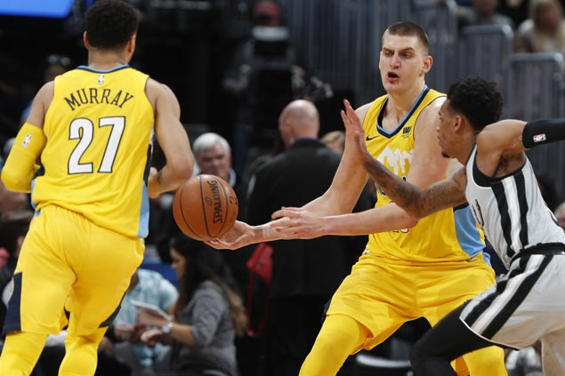 Nikola Jokic posts triple-double before fouling out and Nuggets hold on to beat Spurs