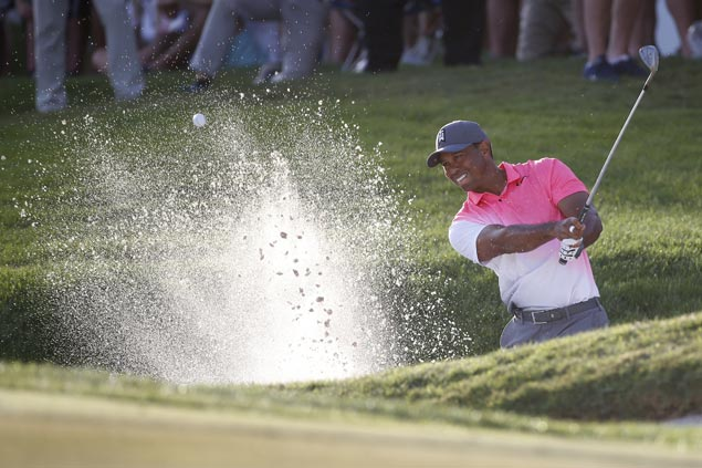 Another solid round keeps Tiger Woods within striking distance at PGA National