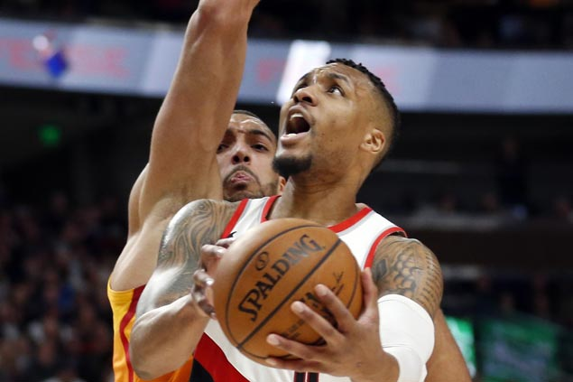 Damian Lillard scores 40 including last-gasp layup to lift Blazers over sputtering Suns