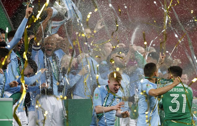 Guardiola finally claims first trophy with City as old guard star in Carabao Cup final win over Arsenal