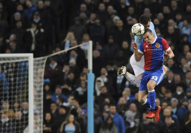 Man City squeezes into Champions League quarters with home loss to Basel