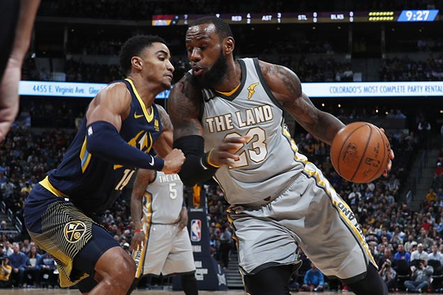 LeBron James takes over down the stretch as Cavs turn back skidding Nuggets