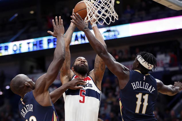 Wizards cruise to victory, end Pelicans' win run at 10 with AD out injured