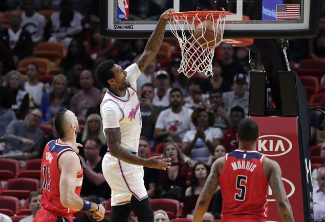 Johnson stars as Heat score wire-to-wire win over Wizards but Wade suffers hamstring strain