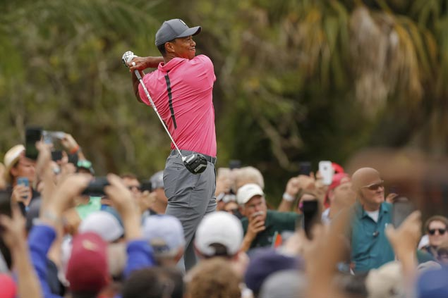 Tiger excites crowd with 67, stands a stroke off pace entering final round at Innisbrook