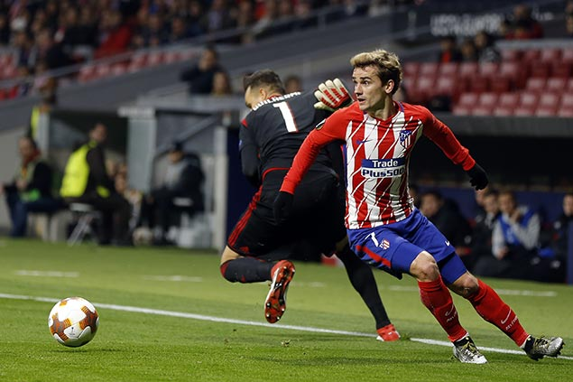 Griezmann carries Atletico Madrid over Celta Vigo to keep pace with La Liga leader Barcelona
