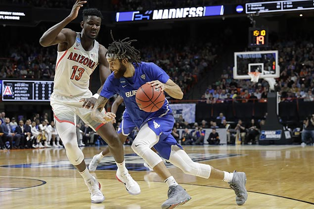 Buffalo pulls off biggest upset of NCAA tournament opening round with rout vs Arizona
