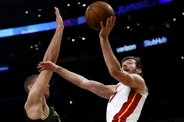 Goran Dragic powers Heat past Lakers to forge virtual tie for seventh in East