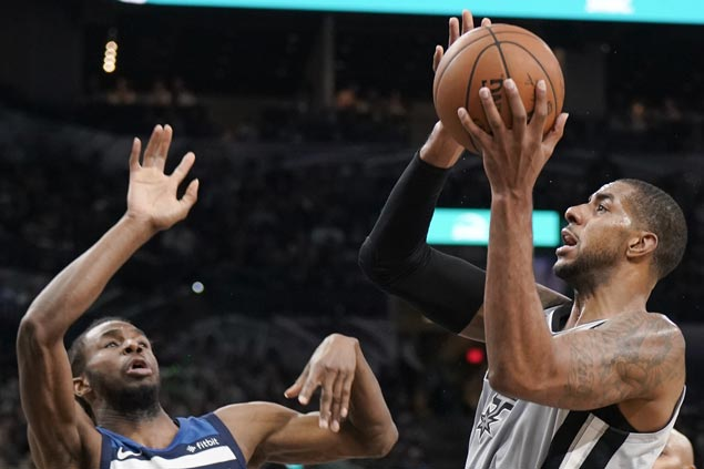 Spurs back in middle of West playoff race, beat Wolves for third straight win