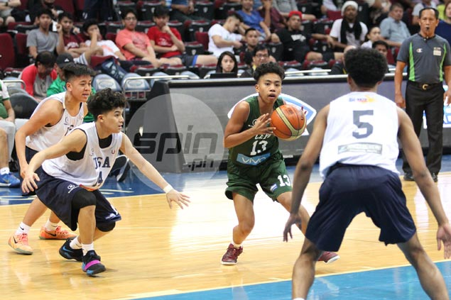 UV guard Steve Nash Enriquez holds ground against much taller Fil-Am opponents