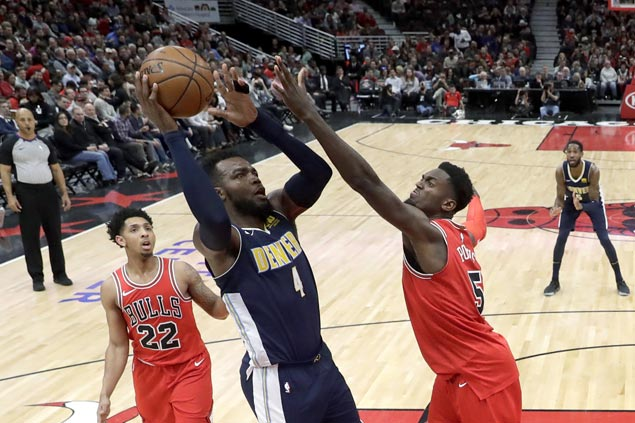 Nuggets rout Bulls to close gap on Jazz in race for eighth spot in West